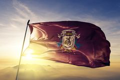 Caracas Capital District State of Venezuela flag textile cloth fabric waving on the top sunrise mist fog. Beautiful stock photography