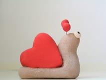 Caracol con la cáscara bajo la forma de corazón Foto de archivo libre de regalías
