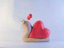 Caracol con la cáscara bajo la forma de corazón Imágenes de archivo libres de regalías