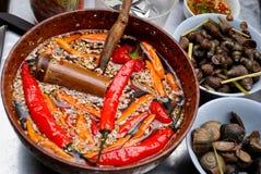 Caracoles y pimientas de Chile, Hanoi, Vietnam Foto de archivo libre de regalías