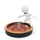 caractère 3D restant sur la roulette Photos stock