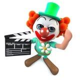 caractère fou de clown de la bande dessinée 3d drôle tenant une claquette de cinéastes Images libres de droits