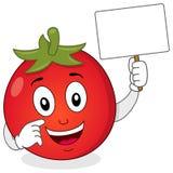 Caractère mignon de tomate tenant la bannière Photographie stock