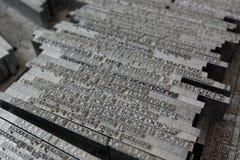 Caractères de linotype en métal photographie stock