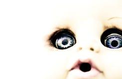 Caractéristiques effrayantes de poupée photo stock
