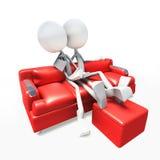 caracteres 3D que miran la televisión del sofá Imágenes de archivo libres de regalías