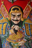 Caracteres de dios del chino tradicional en la puerta Fotos de archivo
