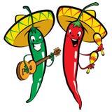 El carácter rojo y verde del chile picante sazona al grupo de la música con pimienta Foto de archivo