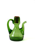 Carafe. A green carafe for olive oil isolated on white background Stock Photo