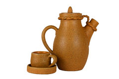 Carafe and coffee cup. Clay carafe and coffee cup (isolated object royalty free stock photography
