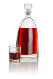 Carafe and drinking glass filled with brown liquid Royalty Free Stock Image