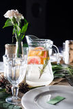 A carafe of fruity beverage with rosemary and Royalty Free Stock Photos