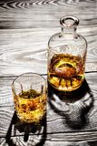Carafe and a glass of aged cognac on a wooden Royalty Free Stock Photos