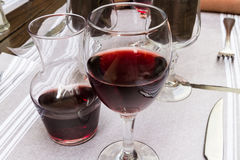 Carafe and glass of red wine, set table. Royalty Free Stock Photo