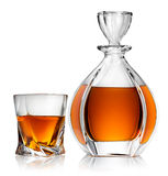 Carafe and glass of whiskey. Isolated on a white background Royalty Free Stock Image
