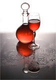 Carafe and a glass with wine. Stock Images