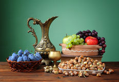 Carafe of metal and various fruits Royalty Free Stock Photography