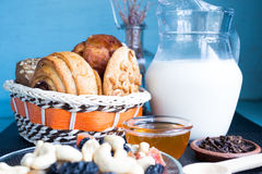 Carafe of milk with baked peanut butter cookies Stock Image