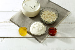 Carafe of milk, sour cream, cottage cheese in cups Stock Photography