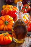 Carafe of olive oil and ripe beef tomatoes Stock Image