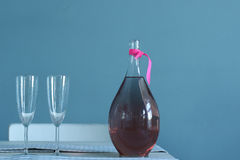 Carafe of red wine and two glasses for rendezvous Stock Images