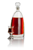 Carafe and schnapps glass filled with brown liquid Royalty Free Stock Photo