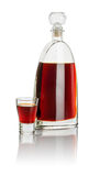 Carafe and shot glass filled with brown liquid Royalty Free Stock Image