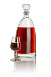 Carafe and snifter filled with brown liquid Stock Image
