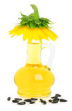 Carafe with sunflower oil and a sunflower on it Stock Photo