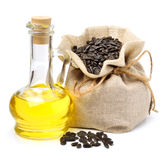 Carafe with vegetable oil and bag with sunflower seeds Stock Photo