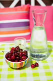 Carafe water and cherries Royalty Free Stock Image