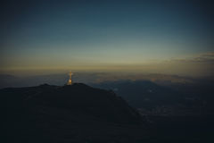 Caraiman Peak Cross - Buegi Mountains. Located on top of the Caraiman peak in the Bucegi mountains of Romania, the cross is visible from both Busteni and Sinaia Stock Images