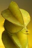 Carambola #3. Carambola, water and mirror surface Stock Photography