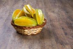Carambola. Basket of ripe star fruit on wood royalty free stock photography