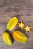Carambola. Basket of ripe star fruit on wood stock image