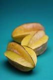 Carambola fruit on blue background Royalty Free Stock Photos