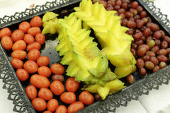 Carambola, grape and cherry tomato Royalty Free Stock Photos