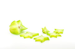 Carambola pieces. Carambola star fruit piece with scattered slices isolated on white Royalty Free Stock Photo