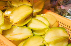 Carambola, starfruit in basket. Outdoor starfruit at vendor stand in Carbbean Royalty Free Stock Photos