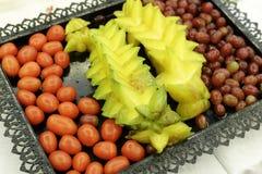 Carambola, uva e pomodoro ciliegia Fotografie Stock Libere da Diritti