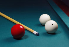 Carambole billiard balls. White and red carom balls with billiard cue on pocketless table Royalty Free Stock Photo