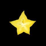 Carambolier - fruit d'étoile d'isolement sur le fond noir Photographie stock libre de droits