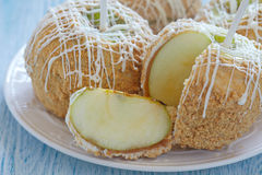 Caramel apple covered with white chocolate Royalty Free Stock Images