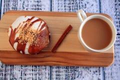 Caramel Apple doughnut and coffee Stock Photo