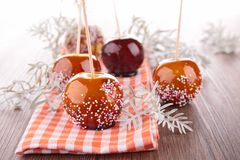 Caramel apple on stick Royalty Free Stock Image