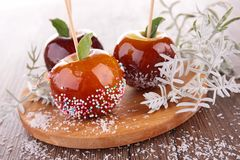 Caramel apple on stick. On wood Stock Images