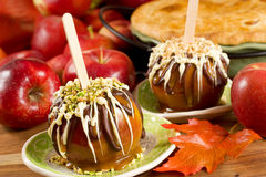 Caramel apples. Topped with chocolate and nuts Royalty Free Stock Photo