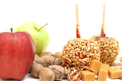 Caramel apples with ingredients on white Royalty Free Stock Image