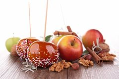 Caramel apples and ingredients Stock Images