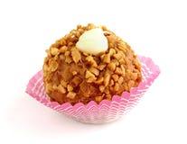 Caramel ball. A sweet caramel ball on white background Stock Photo
